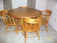 Solid maple wood table and 4 captain chairs $400 or