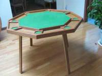 42 inch octagon game table. Seats 8 players; has