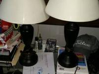 Two black lamps with white shades.