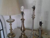 4 table lamps and 1 shade. With CFL bulbs. Two lights