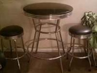 im selling a nice bar stool table with 2 stools for 60