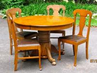 "A beautiful 45"" round oak pedestal table with paw feet."