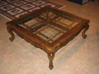 This is a beauitiful solid oak coffee table with four