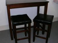 Bar-Style Wooden Table. Two Wood Stools with Padded