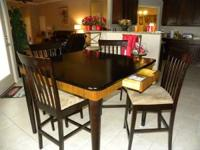 Black Table with 4 drawer and 4 chair, good condition.