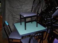 Table with 4 chairs: $55.00 Black frame and vinyl