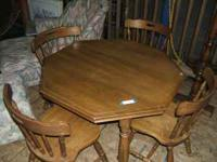 Nice sized round table with four chairs. Perfect for a