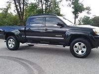 Toyota Tacoma TRD 4WD 2005 82,585 miles.  My