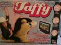 This is a like new in box taffy video game, just plug