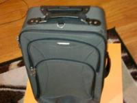 TAG Handbag Rolling Luggage that is in great condition