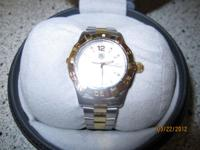 I am selling my wifes Tag Heuer Aquaracer watch,