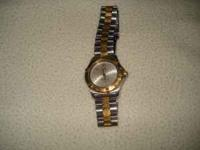 1-owner, barely used stainless/gold watch. Paid over