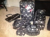Brand new, never used, matching 5-piece luggage set