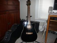 Takamine acoustic/electric guitar in nice shape. Plays