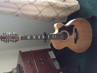 Exceptional maple body, spruce top 12 string guitar. It