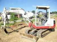 For sale is a lightly used Takeuchi mini excavator.