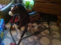 beautiful rocking horse, he talks, sings, shakes his