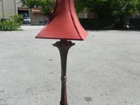 We are selling a Tall Antique Lamp. It has a gorgeous