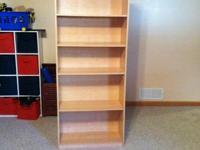 Nice 4 shelf tall bookcase. Overall in sturdy