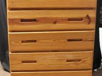 This is a sturdy 5 drawer chest of drawers by Cargo -