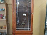 Tall and slender wood cupboard w/ glass door  $145