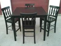 Newly painted black wood dining table and 4 chairs.
