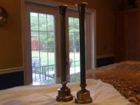 Pair of metal candlesticks. 26in. tall. Selling the