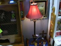 "Tall lamp with striking shade. Measures 12""x32"". Vendor"