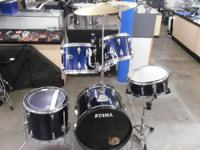 It has bass drum, tom tom, 1 cymbal and floor tom.