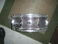 This is a Tama Piccolo snare. It's 4x13 inches. Has a