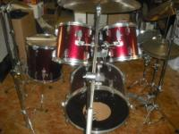 Kit contains metallic red Tama Rockstar Drumset (snare,