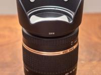 This lens is in PRISTINE CONDITION. If you're looking