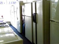 TAN HOTPOINT REFRIGERATOR AND MATCHING ELECTRIC STOVE