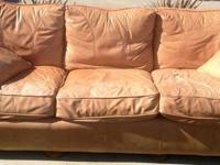 Tan/Caramel leather sofa with 2 leather throw cushions.