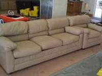 WE HAVE A TAN LETHER SOFA AND LOVE SEAT THEY ARE