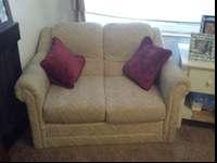 Comfy, tan loveseat for sale. I am moving to Alaska and
