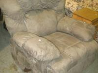This is a very nice tan micro fiber recliner. It is in