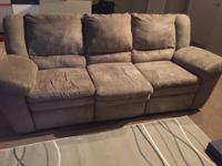 Used, reclining couch for sale in downtown Kansas City.