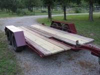 12 foot tandem trailer. Fixed axles, surge brakes, new