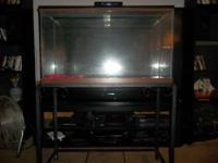55 gal- has wood back instead of glass retpile/animal