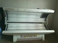 Sunvision Tanning Bed. 310 hours on the bulbs. White in