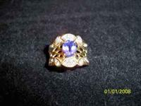 This is a Tanzanite ring , stone size of 6mm x 8mm