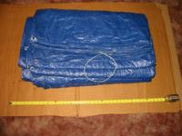 A blue 20' x 50' made use of tarpaulin. Actual