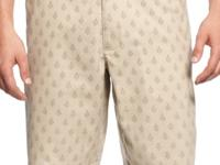 Accessorize these patterned shorts by Tasso Elba with a