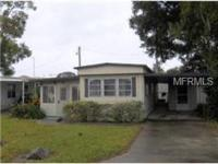 Nice 1970's, 2 bed 1 bath mobile home on Lake Eustis.