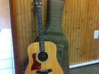 Nearly new left-handed Taylor 110 E guitar and gig bag