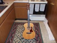 Taylor 412 guitar with Taylor case. Solid mahogany back