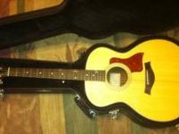 This is a Mint condition Taylor 214E guitar with the