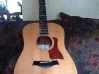 Taylor acustic electric Big baby guitar. Had a $350.
