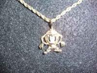 Unique custom made 14 carat gold Taz Charm with 1/4